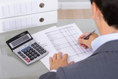 a business accountant and a calculator